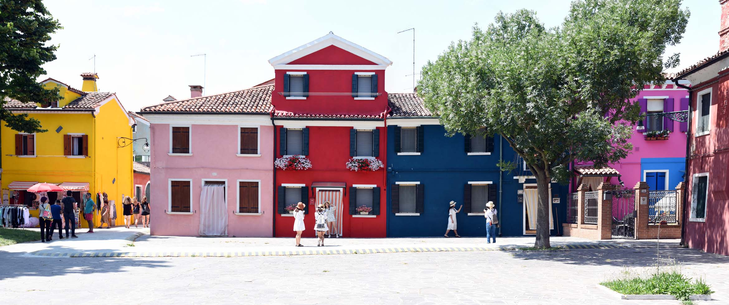 Girls modeling in front of Burano houses